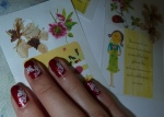 Cherry Blossoms we used as bookmarks with my red nails... ^__^